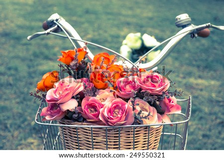Vintage bicycle with a basket of flowers - stock photo