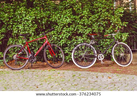 Vintage bicycle with green leaf background - stock photo