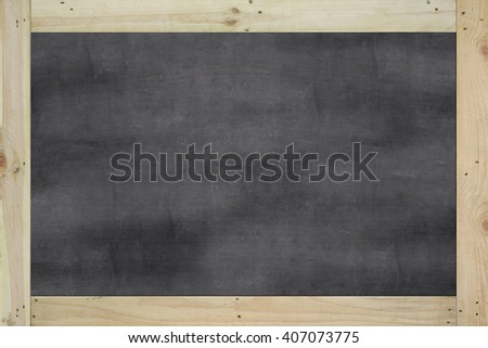 Vintage big rectangular chalkboard/blackboard with wood frame, with traces removing or erase, black color surface. background texture. - stock photo