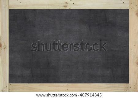 Vintage big rectangular chalkboard/blackboard with wood frame, with traces removing or erase, black color surface. background texture.