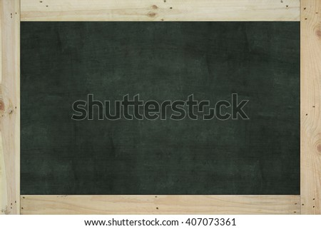 Vintage big rectangular chalkboard/blackboard with wood frame, with traces removing or erase, dark green color surface. background texture.