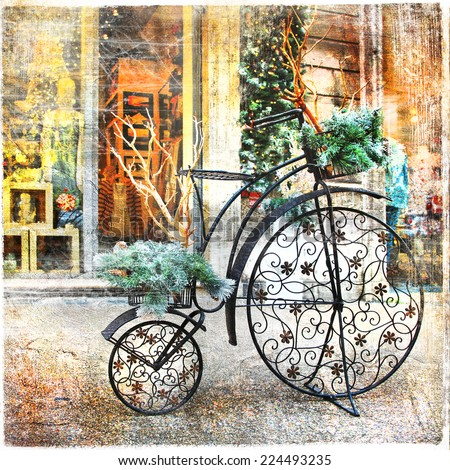 vintage bike , christmas decoration in street, retro styled pictu - stock photo