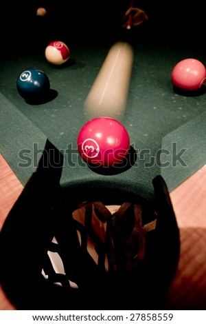 Vintage billiard balls on green table