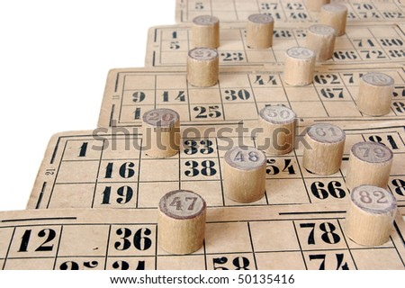 Vintage bingo cards and numbers isolated on white background . - stock photo