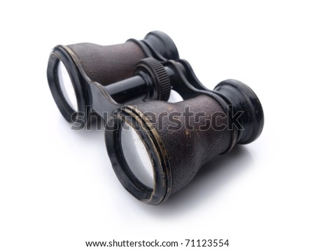 Vintage binoculars with brass parts and leather exterior, isolated on white with natural shadows. - stock photo