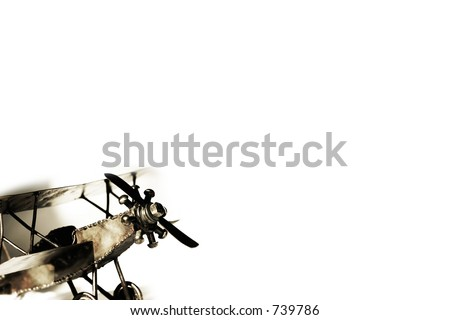 Vintage biplane replica with shadow on white - transportation and travel.