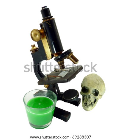 Vintage black and gold microscope grouped with a skull and a glass of toxic green water on a pure white background