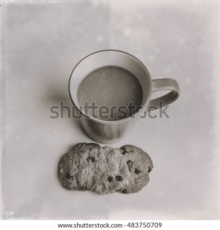 Vintage black and white coloring dust and scratch stlye of staking cookie and mug on white background