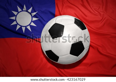 vintage black and white football ball on the national flag of taiwan - stock photo