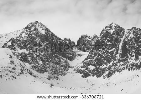 Vintage black and white photo os snow covered mountains - stock photo