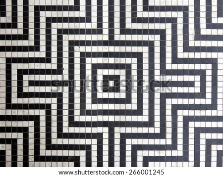 Vintage black and white tile flooring pattern, with dirt marks showing