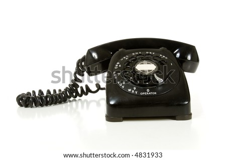 Vintage black desk telephone from the 1950's on white background