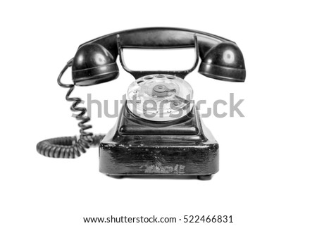 Vintage black phone on a white background. Isolated