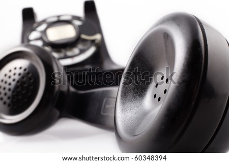 Vintage black rotary phone - stock photo