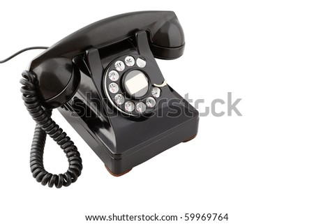 Vintage black rotary phone (with clipping path) - stock photo