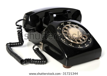 Vintage black telephone over a white background