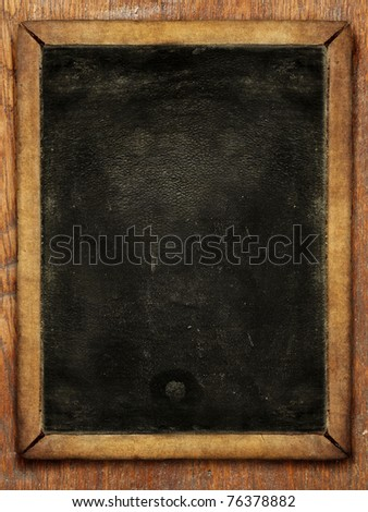 Vintage blackboard isolated on wooden background