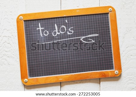 Vintage blackboard, to do's, task list - stock photo