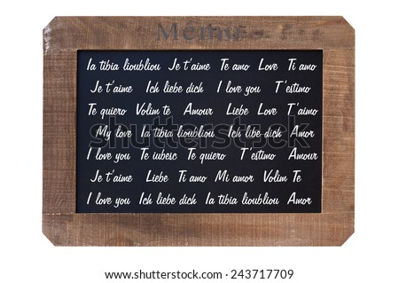 Vintage blackboard with the words I love you translated in many languages - stock photo