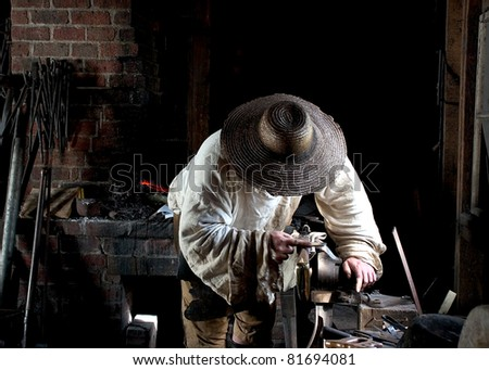 Vintage Blacksmith at Work - stock photo