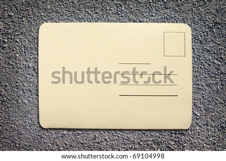 vintage blank card on asphalt texture background with copy space - stock photo