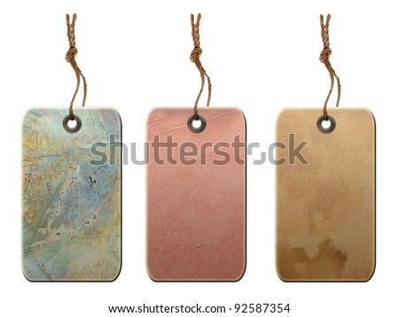 Vintage blank gift tags with string isolated on white background.
