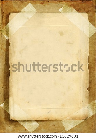 vintage blank page from photoalbum with tapes - stock photo