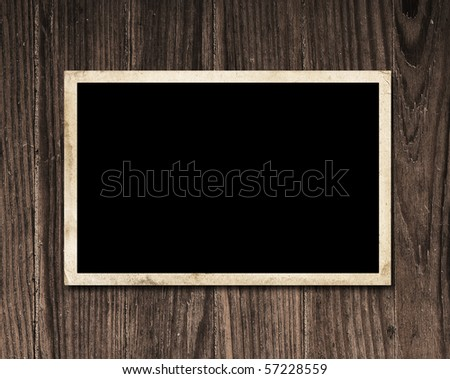 Vintage blank photo on wooden table with copy space. - stock photo