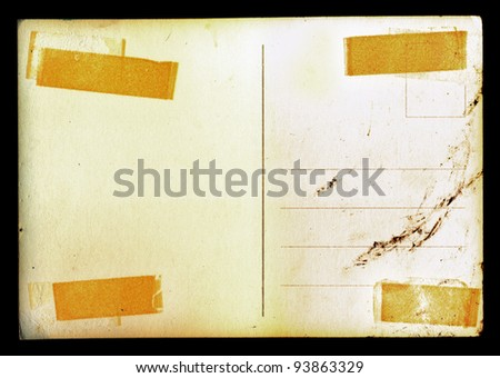 Vintage blank postcard background with adhesive tape stains and ink smudge. - stock photo