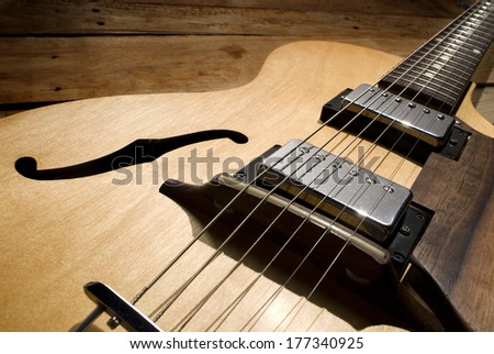 vintage blonde jazz guitar close up - stock photo