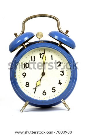 vintage blue clockwork alarm clock showing 7 o'clock