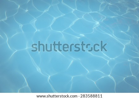 Vintage Blue pool water with sun reflections background - stock photo