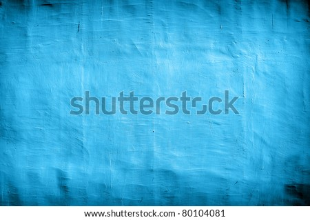 vintage blue wall as background with artistic shadows added - stock photo
