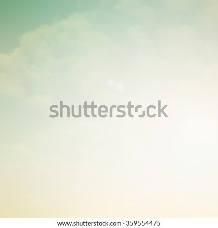 vintage blurred beautiful natural sky clouds landscape background with lights.blurry sunshine wallpaper concept.backdrop pastel tone.idyllic shores sundown hour.abstract dream magic coastline dramatic - stock photo