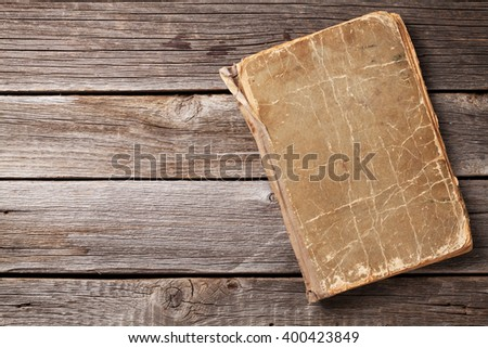 Vintage book on wooden background. Top view with copy space - stock photo