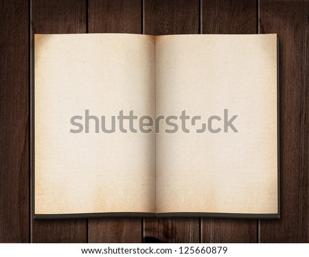 Vintage book on wooden table. - stock photo