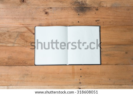 vintage book open on old wooden table - stock photo