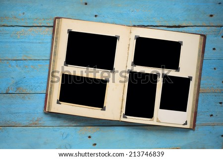 vintage book or photo album with empty photo frames, photo corners, free copy space - stock photo