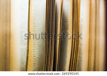 vintage book pages fluttering - stock photo