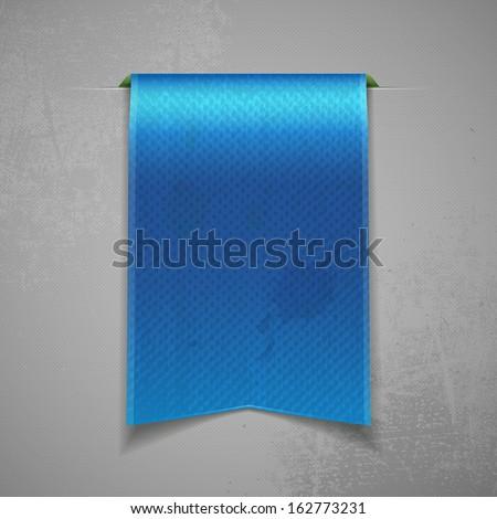 Vintage bookmark ribbon on grey background - stock photo
