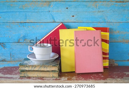 vintage books and a cup of coffee, free copy space - stock photo