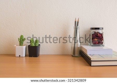 Vintage books and bottle wooden table. - stock photo