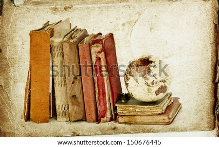 Vintage books and globe  - stock photo