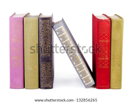 vintage books in a row, isolated on white background - stock photo