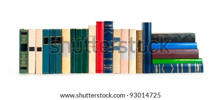 vintage books in a row, isolated on white background, clipping path, empty labels with free copy spac - stock photo