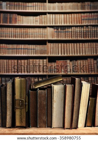 vintage books on wooden shelf. - stock photo