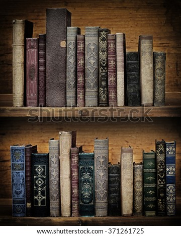 vintage books on wooden shelf. - stock photo