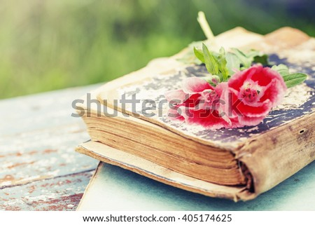 Vintage books with bouquet of field flowers/ nostalgic summer background - stock photo