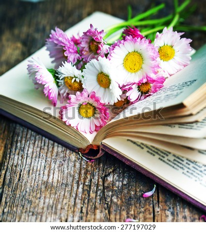 Vintage books with bouquet of flowers/ nostalgic vintage background