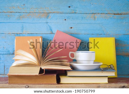 vintage books with coffee cup and specs, free copy space  - stock photo